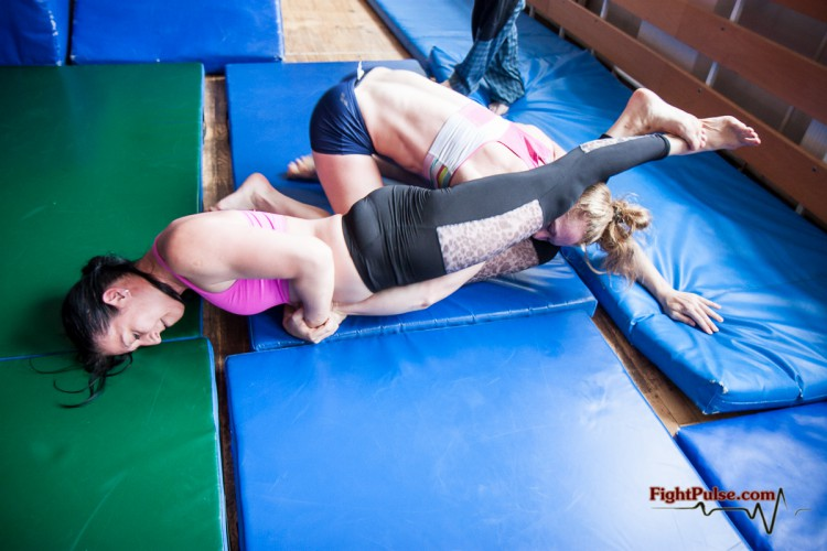 competitive female wrestling headscissors