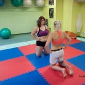 competitive female wrestling staredown