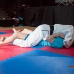 Judoka pinning down male
