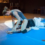Viktoria on top pinning Steve's wrists down