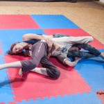 Reverse headscissors & gut wrench combination hold by Katniss