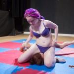 Revana straddling her opponent's face