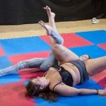 Lucrecia leg-wrestling Katniss