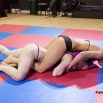 competitive female wrestling match between Jane and Revana