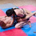 Marek scissors Karina's body