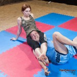 Marek in pain in Akela's tight headscissors