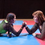 Lucrecia and Jane arm-wrestling