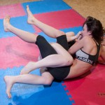 wrestlers struggling for advantage with legs interlocked