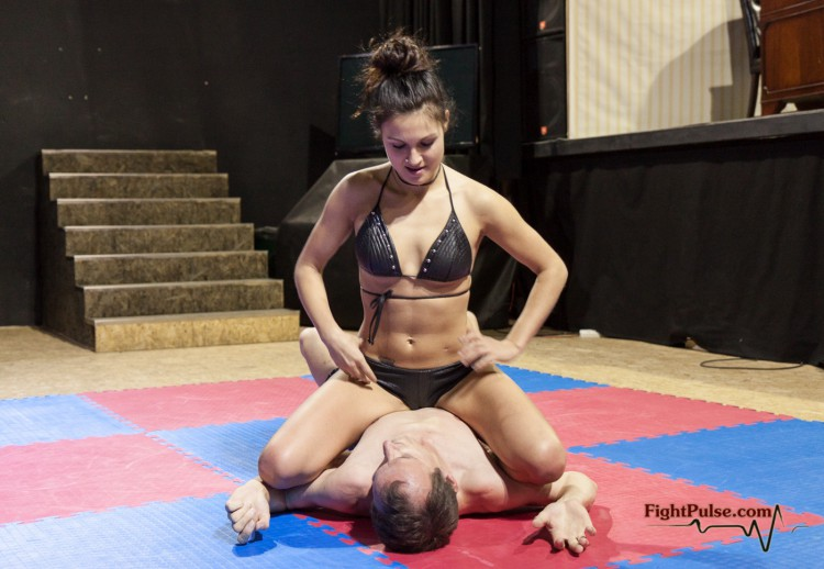 Jane condifently straddling the chest of her male opponent