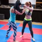 Akela and Zoe fingerlock wrestling