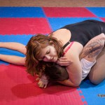 Lucrecia going for the smother submission